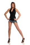 Giovane donna che porta una mini posizione del pannello esterno Fotografia Stock