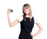 Giovane donna che tiene macchina fotografica digitale Immagine Stock Libera da Diritti
