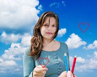 Giovane donna con cuore. Fotografie Stock