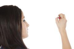 Giovane donna con distogliere lo sguardo della penna Immagine Stock