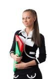 Giovane donna con i dispositivi di piegatura Fotografia Stock Libera da Diritti