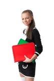 Giovane donna con i dispositivi di piegatura Immagini Stock Libere da Diritti