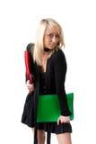 Giovane donna con i dispositivi di piegatura Fotografie Stock