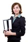 Giovane donna con i dispositivi di piegatura Immagine Stock Libera da Diritti