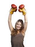 Giovane donna con i guanti di inscatolamento Fotografia Stock