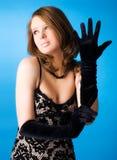 Giovane donna con i guanti eleganti Immagine Stock