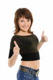Giovane donna con i pollici in su Fotografia Stock