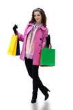 Giovane donna con i sacchetti di colore Fotografia Stock