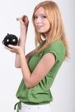 Giovane donna con il contenitore di soldi Fotografia Stock
