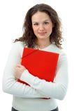 Giovane donna con il dispositivo di piegatura rosso Fotografia Stock Libera da Diritti