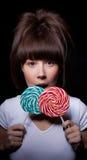 Giovane donna con il lollipop Fotografia Stock