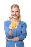 Giovane donna con il succo di arancia Immagini Stock Libere da Diritti