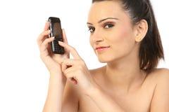 Giovane donna con il telefono delle cellule Immagini Stock Libere da Diritti