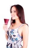 Giovane donna con il vetro del martini immagine stock libera da diritti
