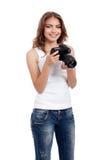 Giovane donna con la macchina fotografica della foto fotografia stock