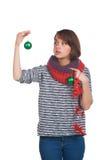 Giovane donna con la palla di natale Immagine Stock Libera da Diritti