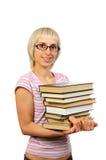 Giovane donna con la pila di libri Fotografia Stock Libera da Diritti