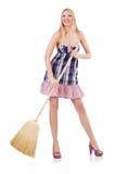 Giovane donna con la scopa Immagini Stock
