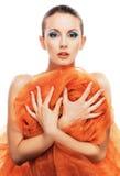 Giovane donna con lo scialle arancione Fotografia Stock Libera da Diritti