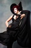 Giovane donna con lo sguardo demonico Fotografie Stock Libere da Diritti