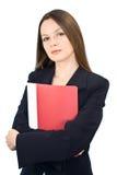 Giovane donna con un dispositivo di piegatura in mani Immagini Stock