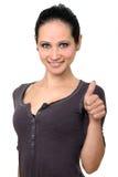 Giovane donna con un pollice sul gesto Immagini Stock