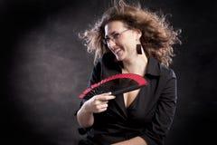 Giovane donna con un ventilatore Fotografie Stock