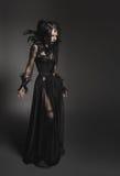 Giovane donna in costume nero di fantasia Immagine Stock Libera da Diritti