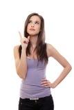 Giovane donna del Brunette che indica in su immagini stock libere da diritti