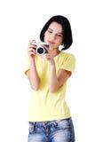 Giovane donna dello studente con una macchina fotografica della foto Immagine Stock