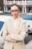 Giovane donna di affari che esamina macchina fotografica Immagine Stock Libera da Diritti