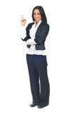 Giovane donna di affari che indica in su Immagini Stock