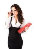 Giovane donna di affari con il dispositivo di piegatura immagini stock