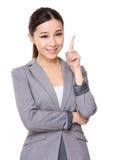 Giovane donna di affari con il punto del dito su Immagini Stock Libere da Diritti