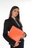 Giovane donna di affari con il raccoglitore arancione dell'archivio fotografie stock