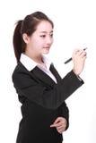 Giovane donna di affari con la penna Immagine Stock