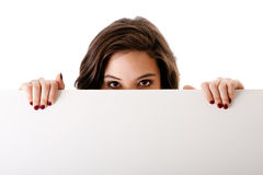 Giovane donna di affari con la scheda bianca Fotografia Stock