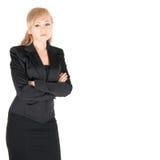 Giovane donna di affari con le armi attraversate sopra fondo bianco Immagini Stock Libere da Diritti