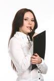 Giovane donna di affari con una penna Fotografie Stock Libere da Diritti