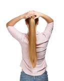 Giovane donna di affari sulla vista bianca della parte posteriore del fondo Immagini Stock