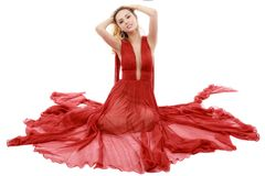Giovane donna di bellezza in vestito rosso d'ondeggiamento Fotografie Stock Libere da Diritti