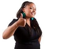 Giovane donna di colore che compone i pollici fotografia stock
