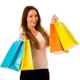 Giovane donna di Preety con i sacchetti della spesa variopinti isolati sopra il whi Immagini Stock Libere da Diritti