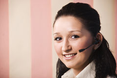 Giovane donna di servizio di assistenza al cliente Immagine Stock Libera da Diritti