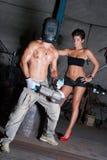 Giovane donna ed uomo in fabbrica Immagine Stock Libera da Diritti