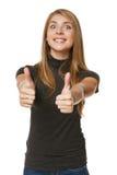 Giovane donna emozionante di successo che dà i pollici su Fotografia Stock