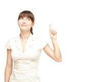 Giovane donna felice che indica verso l'alto Immagine Stock