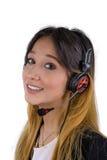 Giovane donna felice che lavora alla call center Immagine Stock Libera da Diritti