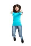 Giovane donna felice che salta con i pollici su Fotografia Stock Libera da Diritti
