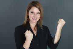 Giovane donna felice che serra i suoi pugni Fotografia Stock Libera da Diritti